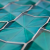 Glass tile features shapes and prismatic effects reminiscent of origami